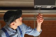 Man fixing a garage door opener